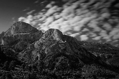 Long exposure of Cornador Grand and Cornador Petit peaks above Fornalutx village in Mallorca. (Brian_B_Images) Tags: sun outdoors mountainscape landscape balearic xt1 fujifilm fuji intense mood clouds gr221 fornalutx bigstopper leefilters longexposure majorca spain mallorca tramuntana cornadorpetit cornadorgrand mountain bnw bw blackandwhite