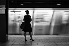 M Nights (John St John Photography) Tags: streetphotography candidphotography 34thstreet heraldsquare subwaystation mta woman standing silhouette train moving blur slow shutterspeed blackandwhite blackwhite bw monotone newyorkcity newyork peopleofnewyork