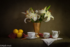 Still life with lilies and lemon. (Phyllis Freels) Tags: phyllisfreels white arrangement creamer flowers gold green lemon lilies napkin stilllife sugardish tabletop teacup vase vintage yellow