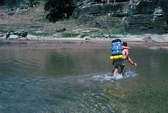Goulburn River, NSW, 1984 (NettyA) Tags: 35mm australia spanunlimited film scannedslide 35mmslidefilm nsw newsouthwales goulburnriver goulburnrivernationalpark rivercrossing bushwalking bushwalkers carrying person 1984