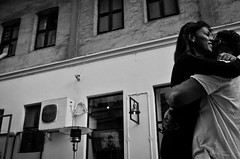 Joy (stimpsonjake) Tags: nikoncoolpixa 185mm streetphotography bucharest romania city candid blackandwhite bw monochrome joy hug embrace boyfriend girlfriend love romance couple