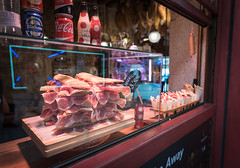 Butcher shop in Toledo, Spain (kellyjrusso) Tags: deli d750 butcher cathedral church street andalusia andalucia catedral nikon spain sale shop window espana jamon architecture ham meat sell store toledo