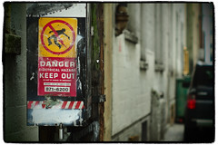 """Electrical Hazard"" (Eric Flexyourhead) Tags: city urban canada detail sign vancouver warning alley downtown bc bokeh britishcolumbia pinhole lane worn weathered vignette patina fragment electricalbox artfilter smcpentax55mmf18 olympusem5"