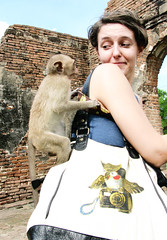 Covered in monkeys (eweliyi) Tags: me girl face self bag thailand monkey expression owl ja lopburi 52weeks eweliyi