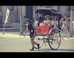 Rickshaw in Otaru (Hokkaido, Japan) (Shanti Basauri) Tags: street boy summer people urban hot men festival japan japanese women funny asia hokkaido candid taxi traditional wheels young july sunny running human tradition rickshaw cinematic otaru matsuri  hokaido 2012 tradicin jinrikisha japn humantaxi ushio japonia   otarushi