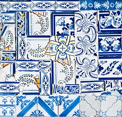 Tiles hodgepodge (Olga Antipenko and Yury Gubin) Tags: old blue white abstract flower building green art geometric portugal yellow horizontal wall architecture facade tile outdoors ceramics european pattern exterior floor expression lisbon traditional group decoration large culture nobody structure architectural handpainted frame repetition backgrounds pottery weathered ornate decor effect portuguese cracked textured obsolete oldfashioned tiled condition tinglazed