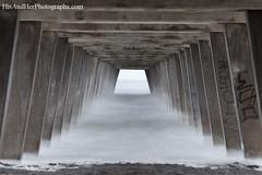 Under the pier (HisPhotographs.com) Tags: beach water fog pier smooth tybeeisland atlanticocean depth longexpsoure bigstopper