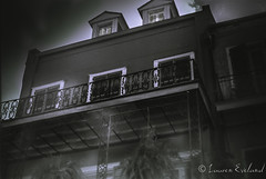 The French Quarter Mystery (laureneveland) Tags: louisiana 35mm ghost spooky haze voodoo frenchquarter 50mm blackwhite iso400 neworleans ultrafine nikon historical house eerie fog film blackandwhite ultrafineiso400 la nola bourbon street building architecture old gas latern haunted wide angle vivitar prime lens tour tourist tourism bw manual 28mm dusk outdoor urban city perspective surreal balcony porch plant