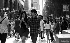 Street scenes in the glowing light (gunman47) Tags: 50mm asia asian b bw mono monochrome orchard road sg sepia singapore time w bag belt black bokeh candid decisive f14 girl hard lens light looking moment people photography portrait precious shopping smile street tourist traffic urban white woman