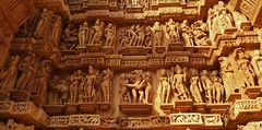 INDIA - Khajuraho Group of Monuments is a group of about 20  Hindu and Jain temples, great reliefs and sculptures,  14235/7102 (roba66) Tags: madhya pradesh khajuraho tempel tempelanlage temple hinduism jainism indien indiennord asien asia india inde northernindia urlaub reisen travel explore voyages visit tourism roba66 city capital stadt cityscape building architektur architecture arquitetura monument bau fassade faade platz places historie history historic historical geschichte tradition culture kultur kulturdenkmal sexual sexual practices erotic chandela kamasutra