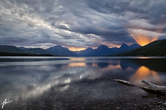 Glacier NP 2 (JH Photographie) Tags: glaciernationalpark apgar village lake mcdonald national park gnp water sunrise light rays clouds reflection nature