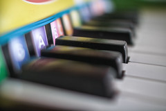 """Learn-to-Play Piano"" By: Melissa & Doug (Jovan Jimenez) Tags: samyang 24mm f14 tiltshift piano instrument music musician children toy baby bokeh bokehful colorful color hue rich keys learn play learntoplaypiano melissa doug eosm3 eos m3 canon manual lens octaves song songbook coded audio sound"