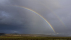 Some Scottish weather over the heather - part II (lunaryuna) Tags: scotland cairngorms nationalpark landscape heather moors hills weather sky clouds rainbow doublerainbow sunrain rain sunshine scottishweather beauty summer season seasonalwonders lunaryuna
