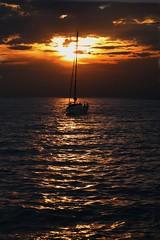 Homeward bound (Steve_66) Tags: sun sunset sea water sky clouds orange silhouette slovenia piran europe sailing yacht yachting stevenolan canon eos waves evening coast coastline summer