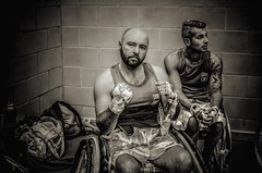 Two of Team Italia before their fights (sophie_merlo) Tags: wheelchair wheelchairsport wheelchairsports adaptivesport adaptiveboxing wheelchairboxing boxing sport sports bw mono monochrome noir documentary photojournalism disablity disabled disabledathlete paralympic chance fight warriors fighters disabledfighters blackandwhite teamitalia italy amputee amputees courage