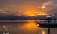 Burnt orange sky at dusk (Photosuze) Tags: sunset sun sky clouds water lake reflection landscape kerncounty pier california hills