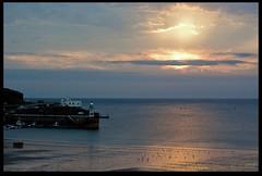 Setting Sun (zweiblumen) Tags: porterin purtchiarn lighthouse sunset isleofman ellanvannin canoneos50d polariser canonef50mmf18ii zweiblumen photoshopcs4