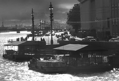University embankment (Vitiaco) Tags: town river bw sun landscape lamp water architecture building road cars bridge people trees summer saintpetersburg glare dazzlement glance wharf quayside cafe wire contrast gray perspective waves sky clouds embankment