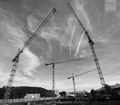 construction site [Explored] (desomnis) Tags: sky blackandwhite bw clouds constructionarea blackwhite construction crane pov perspective sigma wideangle skyandclouds monochrom 1020mm constructionsite buildingsite wideanglelens sigma1020
