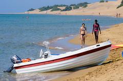 Issos Beach (Kurayba) Tags: girls sea beach water walking island boat women pentax greece beached corfu kerkyra k5 80200 ionian issos ελλαδα pentaxf κέρκυρα f4756 smcpf80200mmf4756 ίσσοσ