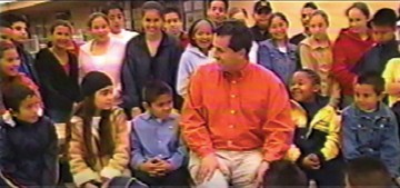 Juan and school children