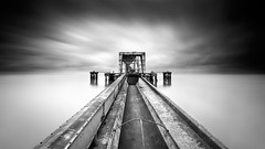 D E E P (CResende) Tags: old longexposure bw motion portugal clouds river pier time decay lisbon le tejo banks cresende