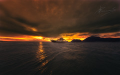 a strip of light is enough (dtsortanidis) Tags: sunset red sea sky orange rio yellow ferry clouds canon photography golden colours purple mark fisheye greece ii 5d 15mm dimitris patra dimitrios antirrio 815mm tsortanidis dtsortanidis