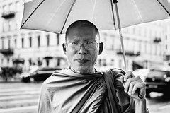 thai monk (red line highway) Tags: thai monk thailand buddhist buddhism philosophy religion man people portrait city temple stpetersburg nikon russia faces light street photography reportage society social documentary rain umbrella 35mm monochrome blackandwhite