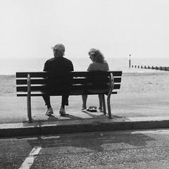 (Attila Pasek) Tags: bournemouth ilford ilfordpanf pentaconsix beach bench couple film groyne shadow