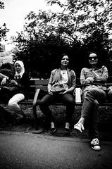 Women at the Park (stimpsonjake) Tags: nikoncoolpixa 185mm streetphotography bucharest romania city candid blackandwhite bw monochrome women bench park sunglasses headcovering