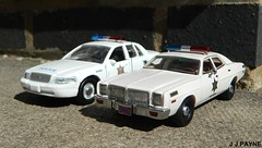 1:43 Hazzard County Sheriff: Old & New (J.J.Pay 8581) Tags: model diecast toy police sheriff dukes hazzard monaco dodge crown victoria vic ford realtoy neo 143