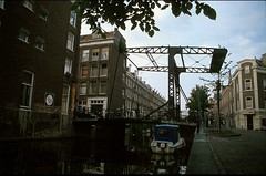 Drawbridge, Jordaan, Amsterdam (GothPhil) Tags: buidlings bridge architecture historical drawbridge canal lijnbaansgracht jordaan ouwefransenbrug willemsstraat amsterdam netherlands august 1992 scanned 35mm waterways holland fujifilm fujichrome asa100
