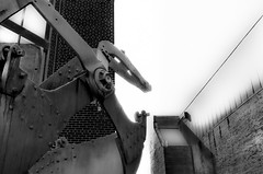 Machines begin their plan to take control of the planet (Noel Leone--my reality in and out of focus) Tags: machine sacramento ca oldbuilding farmmachinery oldtown monochrome museum iastakepower