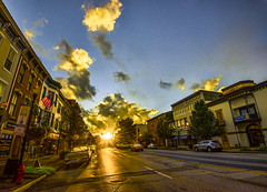 Sunset on Main Street (Bernie Kasper) Tags: art berniekasper color d600 effect family fall light historic histrorichomes jeffersoncounty kasper madisonindiana mainstreet madison landscape nature nikon new naturephotography outdoors outdoor old raw wideangle sunset sun car cars road street highway clouds cloud buildings blue red travel trees tree windows signs summer