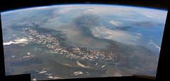 Alps and the Po Valley (sjrankin) Tags: 11september2016 edited nasa panorama iss iss048 iss048e66870 iss048e66871 iss048e66872 italy mediterraneansea povalley alps haze smog pollution earthslimb sunglint