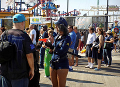 """""""Put em up!"""" (Robert S. Photography) Tags: boardwalk people costumes games woman toygun fun summer rides steeplechase coneyisland brooklyn nikon coolpix color l340 iso80 september 2016"""