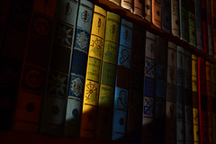 Conspicuous yellow (TheShutterReleaser) Tags: book bookshelf yellow light shade reading vintage colors hardcover collection atnight