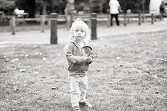autumn has started (Simon in Southend) Tags: sal50f14 sony 50mm amount adapter laea2 f14 a6000 ilce6000 emount toddler child little cute beautiful serious thoughtful leaf autumn leaves petit blonde bokeh blur blurry blury shallow dof park grass bw black white mono monochrome lightroom lr5 analogefexpro2 nik fall southendonsea southend essex priory prittlewell