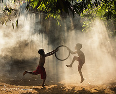 Got it!! (Explored) (Sassy Chris) Tags: morning game tree boys sunshine silhouette children happy play laugh rayoflight
