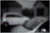 Cars in Rain (SubSeaSniper) Tags: blackandwhite blurry outoffocus grainy daidomoriyama sloppyborders seleniumtint canoneos40d bureboke sifma30mmf14lens