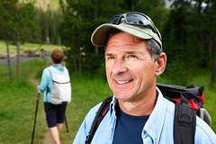 Out for a Hike (www.toddklassy.com) Tags: travel family camping summer vacation portrait man male green tourism nature face grass smiling sport horizontal forest walking outdoors happy parents togetherness moving healthy woods couple fifties adult action head hiking father happiness husband health backpacking wife yellowstonenationalpark excercise 50s recreation hikers wyoming copyspace wilderness activity cheerful fitness nationalparks backpacker twopeople retirement bonding active stockphoto wy caucasian lifestyles selectivefocus wellbeing stockphotography senioradult exercising traveldestinations colorimage woodedpath environmentalportraiture healthylifestyle seniorcouple recreationalpursuit lushfoliage commercialphotographer activepeople toddklassy activecouple