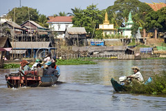 A Cambodian family sails home upriver from Tonle Sap Lake. (dkjphoto) Tags: travel family lake fish tourism home water river boat fishing asia cambodia seasia cambodian tour village tide tourist siemreap stilt raised tonlesap