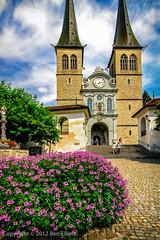 Church of St. Leodegar (benjaminwelliott) Tags: flowers church buildings switzerland europe cityscapes landmarks luzern lucerne vibrantcolours churchofstleodegar