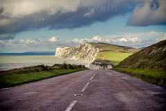 The Road to Freshwater Bay (s0ulsurfing) Tags: road uk november blue light england sky cliff cloud sunlight english grass lines weather tarmac clouds composition rural canon vintage skyscape island coast chalk skies britain pov patterns perspective blues wideangle cliffs nostalgia coastal vectis isleofwight cumulus convergence coastline british roadside isle vignette depth wight foreground 2012 converge verge expanse whitelines westwight coastroad leadinglines freshwaterbay tennysondown tarmacadam militaryroad eptas s0ulsurfing asphaltconcrete a3055 bituminousasphaltconcrete welcomeuk