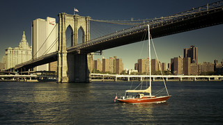 red Boat under Brooklyn Bridge