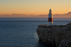 Trinity Lighthouse Gibraltar (Allard One) Tags: africa winter light sunset lighthouse seascape mountains nature water beautiful landscape zonsondergang nikon rocks warm europe december ships surreal cliffs morocco vista afrika gibraltar atlanticocean meet vuurtoren strait connection marokko mediterraneansea connect 2012 rif pillarsofhercules continents iberianpeninsula waterscape europapoint 1841 victoriatower straitofgibraltar theotherside estrechodegibraltar rifmountains baken strog trinitylighthouse d700 britishoverseasterritory europaroad nikond700 nikonfx allardone allard1 rifgebergte gateofcharity babelzakat nikkor70200mmf28vrii fullframepower nikcolorefexpro4 allardschagercom