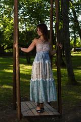 In the swings (Janis Baiza) Tags: model woman dress nature trees tree swing swinging swings blue bluedress shoes necklace outdoor