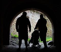 Friends (Aga Dzicio) Tags: tunnel tunel friends men buggy shadows fatherhood walk sightseeing boyen giycko friendship ami amis enfant ensemble