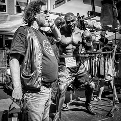 911? Hurry, someone is about to beat me up... (PaulHoo) Tags: square squareformat albert cuyp market amsterdam holland netherlands 2016 summer nikon d700 candid streetcandid streetlife citylife streetphotography people urban 911 alarm boxing call dial communication bw blackandwhite monochrome contrast