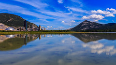 The Origin of Symmetry (djryan78) Tags: building lacdesarcs sigma dslr mountains buildings exshaw canon clouds clear 6d travel cloud alberta afternoon sigma24105 bowriver mountain canadianrockies limestonequarry water lake canon6d 24105 trees summer hills hill tree limestone forest river lafargeexshawplant reflection canada outdoor rockymountains lafarge quarry